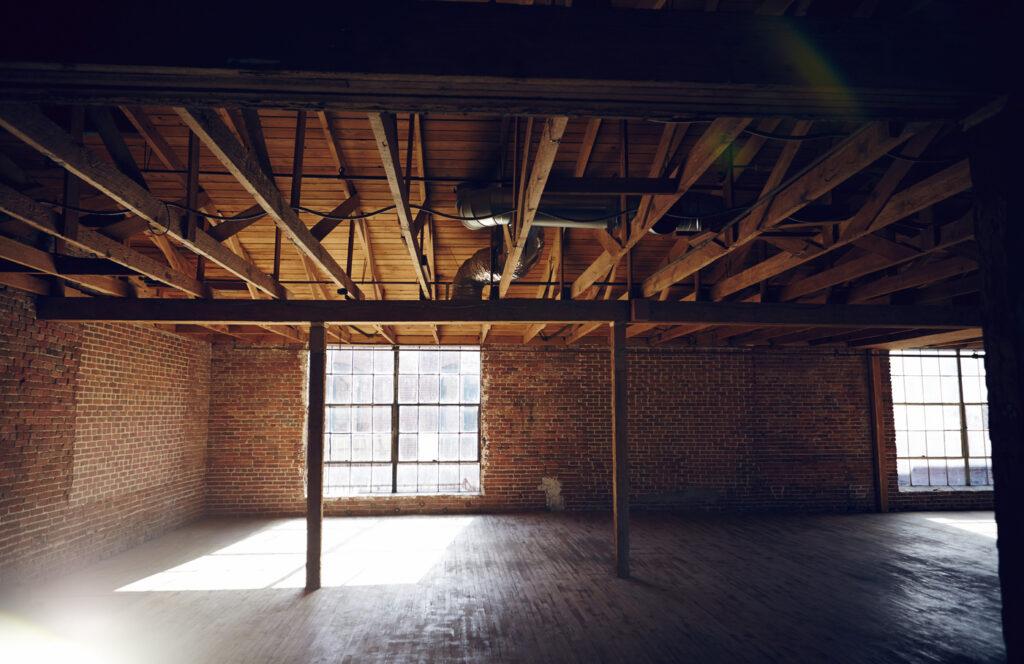 Wood beams and brick walls in empty loft space